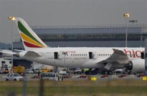 Emergency services attend to a Boeing 787 Dreamliner, operated by Ethiopian Airlines, after it caught fire at Britain's Heathrow airport