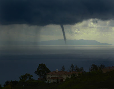 Photo of home perched on Latigo Canyon road with with view of One of Two water spouts about 2-miles off the coast of Pepperdine in Malibu Wednesday afternoon bringing in heavy rain to the area. The other water spout was spotted in the Point Dume Area.  October 27, 2004. (LOS ANGELES TIMES PHOTO BY KEN HIVELY)